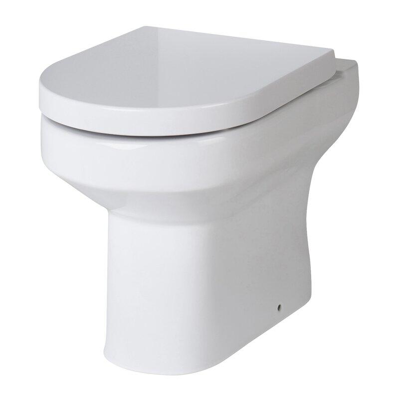 White back to wall toilet