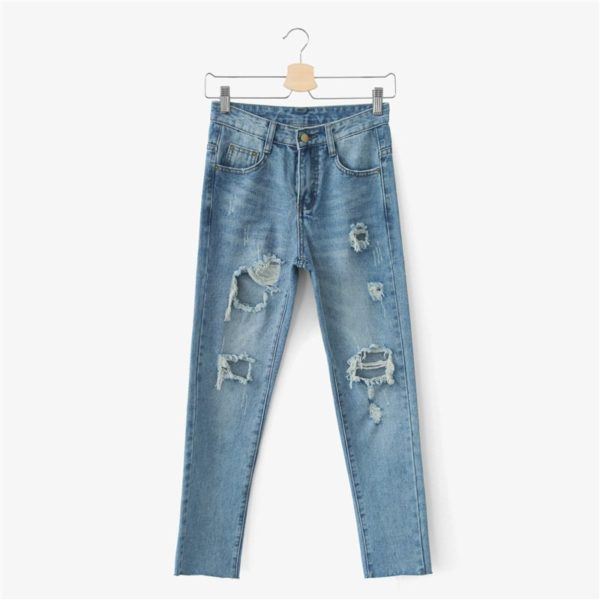 Cut up ripped faded blue jeans
