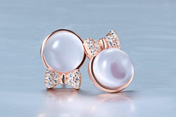 Gemstone bowed gold earrings